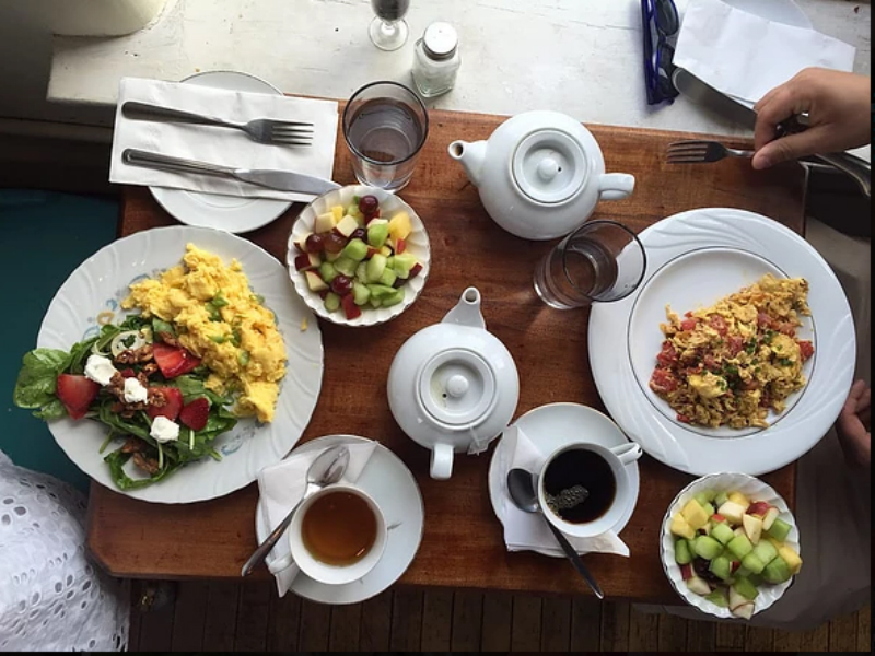 A table with breakfast dishes, fruit, and coffee from The Table Columbus