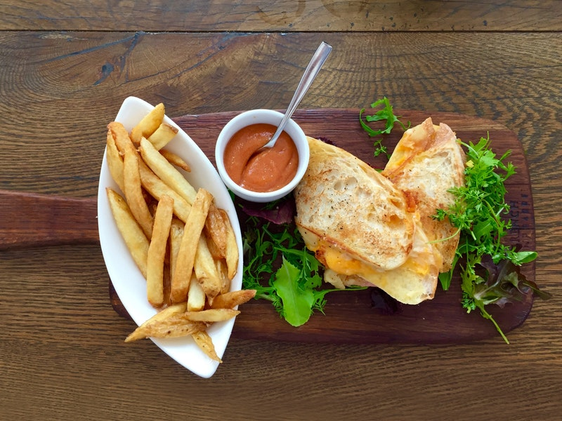 A close-up of fries and a sandwich