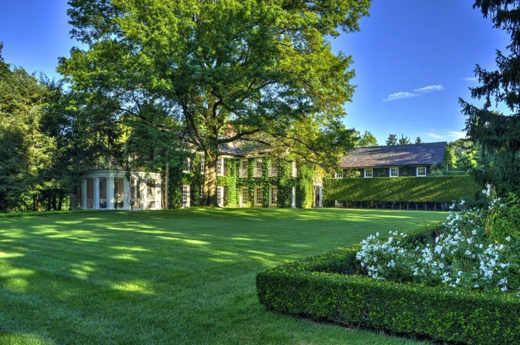 a gorgeous house with a lot of lawn