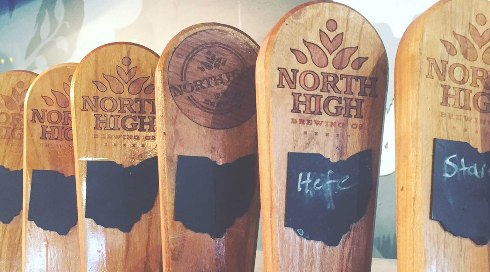 North High Brewing Company branded wooden tap handles