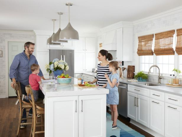 A family gathered around the island in their kitchen