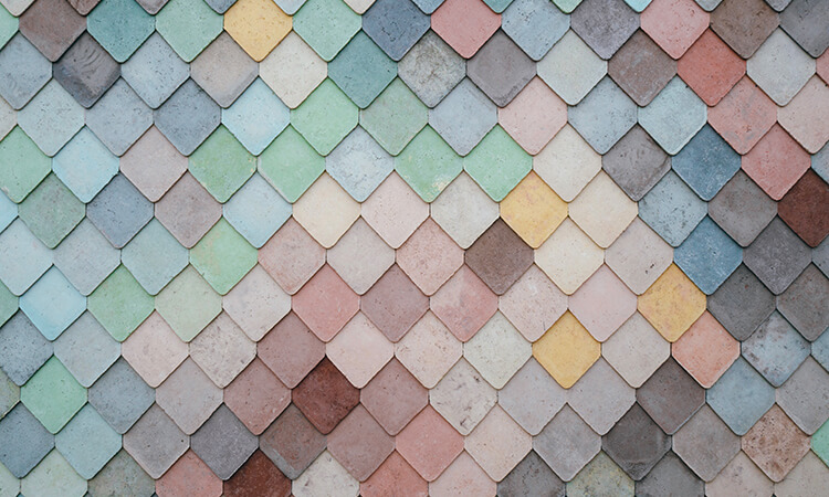 Close up of coloured triangular tiles