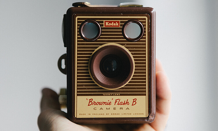 Person holding a Kodak Brownie camera