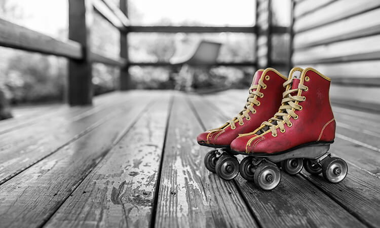 Red rollerskates highlighted on a black and white background