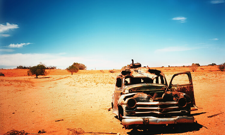 Old rusted car in the desert