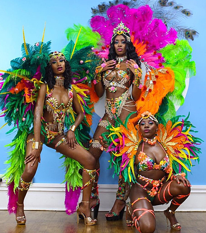Three beautiful models in carnival costumes