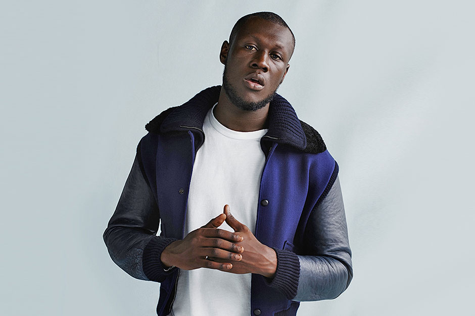 UK rapper Stormzy posing with hands clasped together