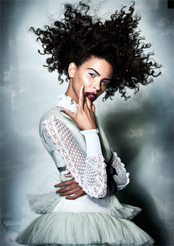 Model from Rick Robert's Afro Hairdresser of the year winning collection. Wearing curly hair and ice blue dress