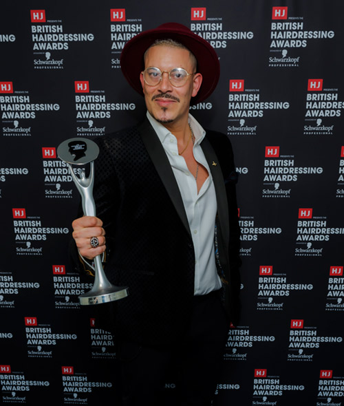 Rick Roberts with HJ British Hairdressing Awards Afro hairdresser of the Year trophy