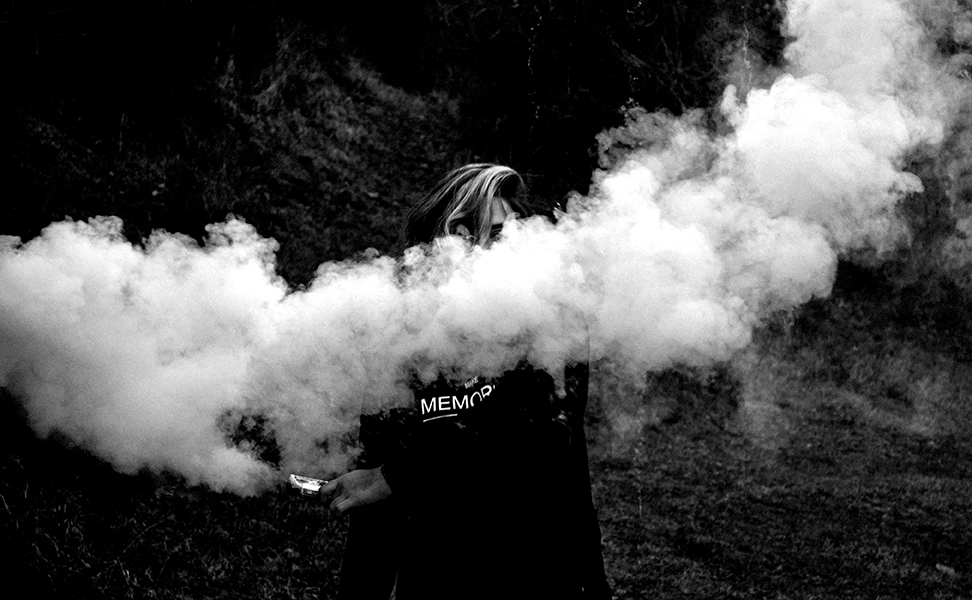 woman with smoke flare