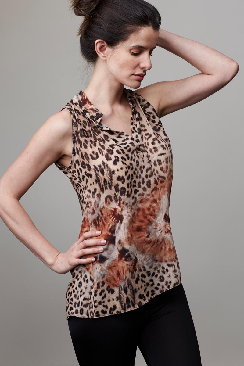 Model wearing floral leopard blouse