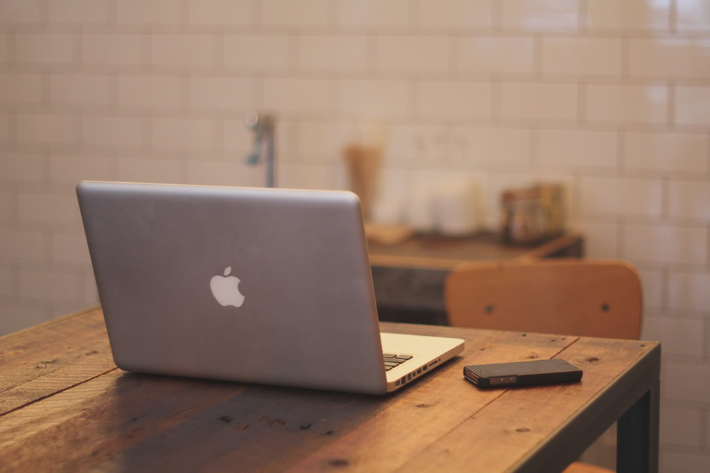 macbook and smartphone on table