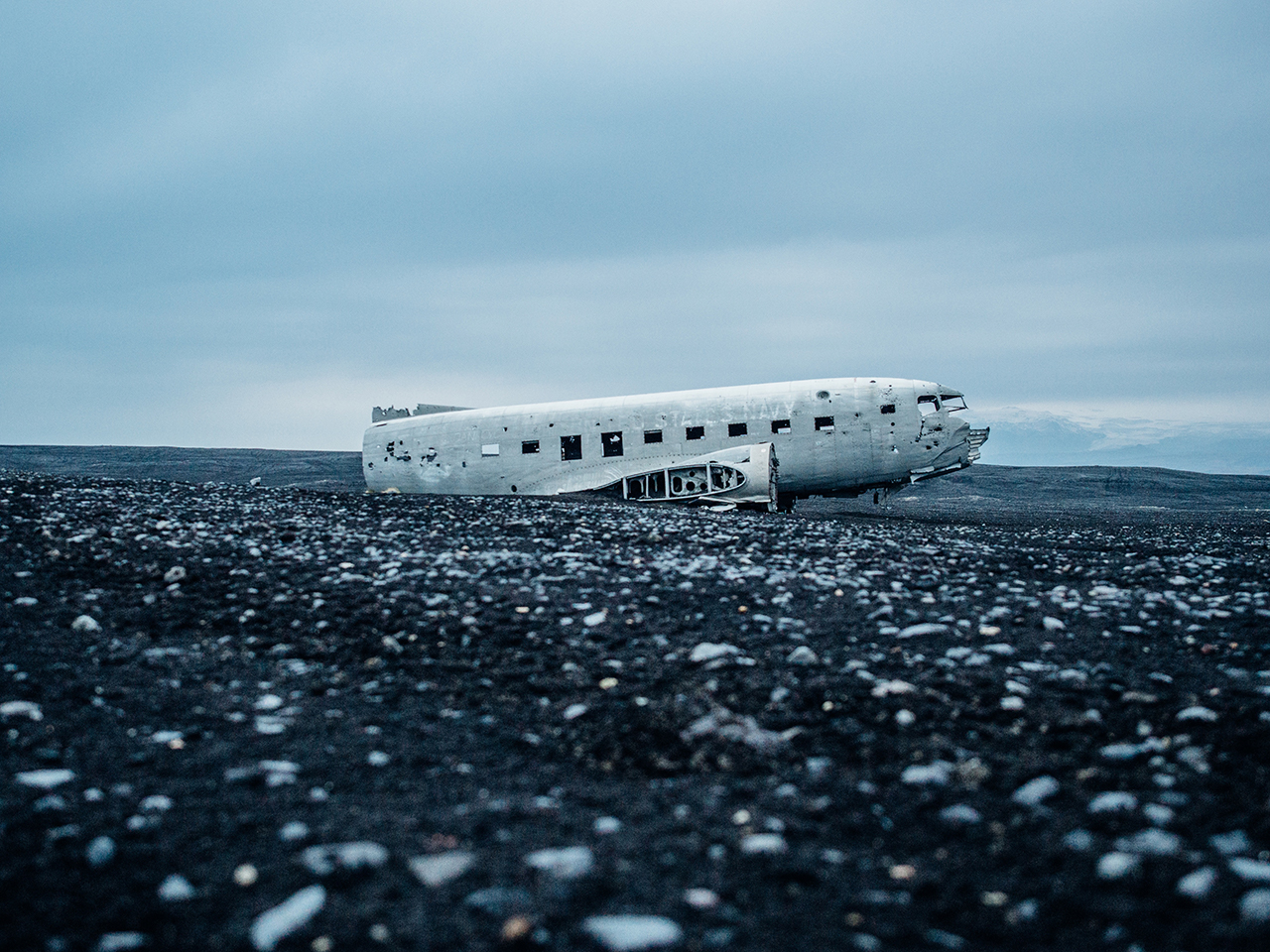 crashed plane on pebbles