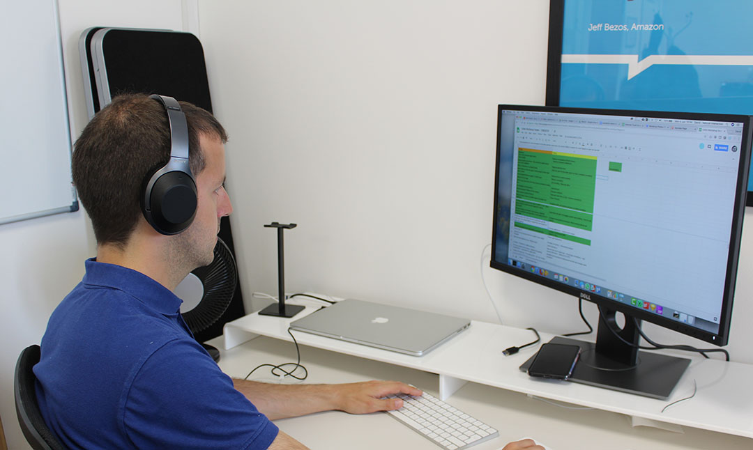 David Crossland at his desk working on some user research