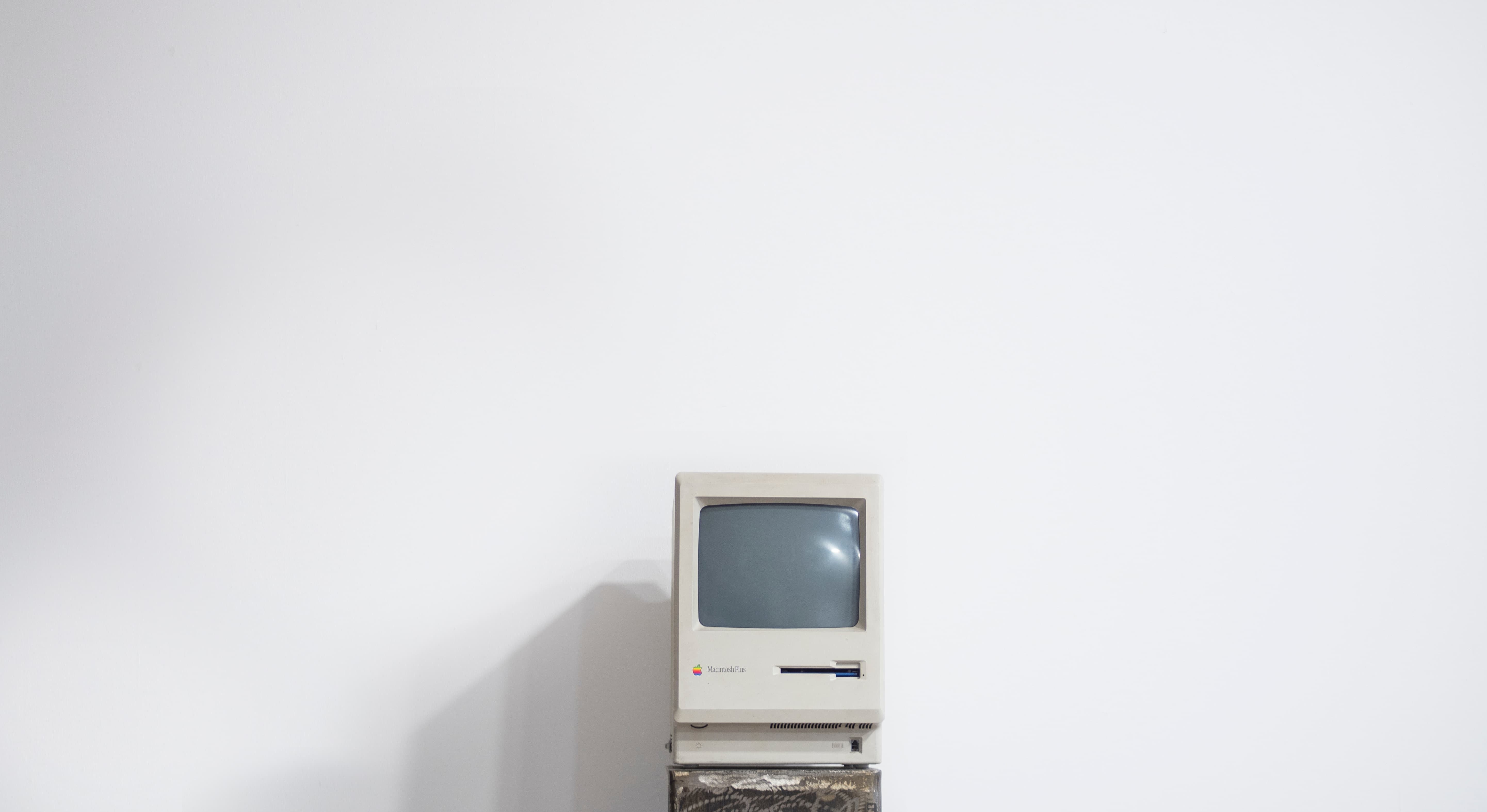 A vintage Mac book pro on a white background
