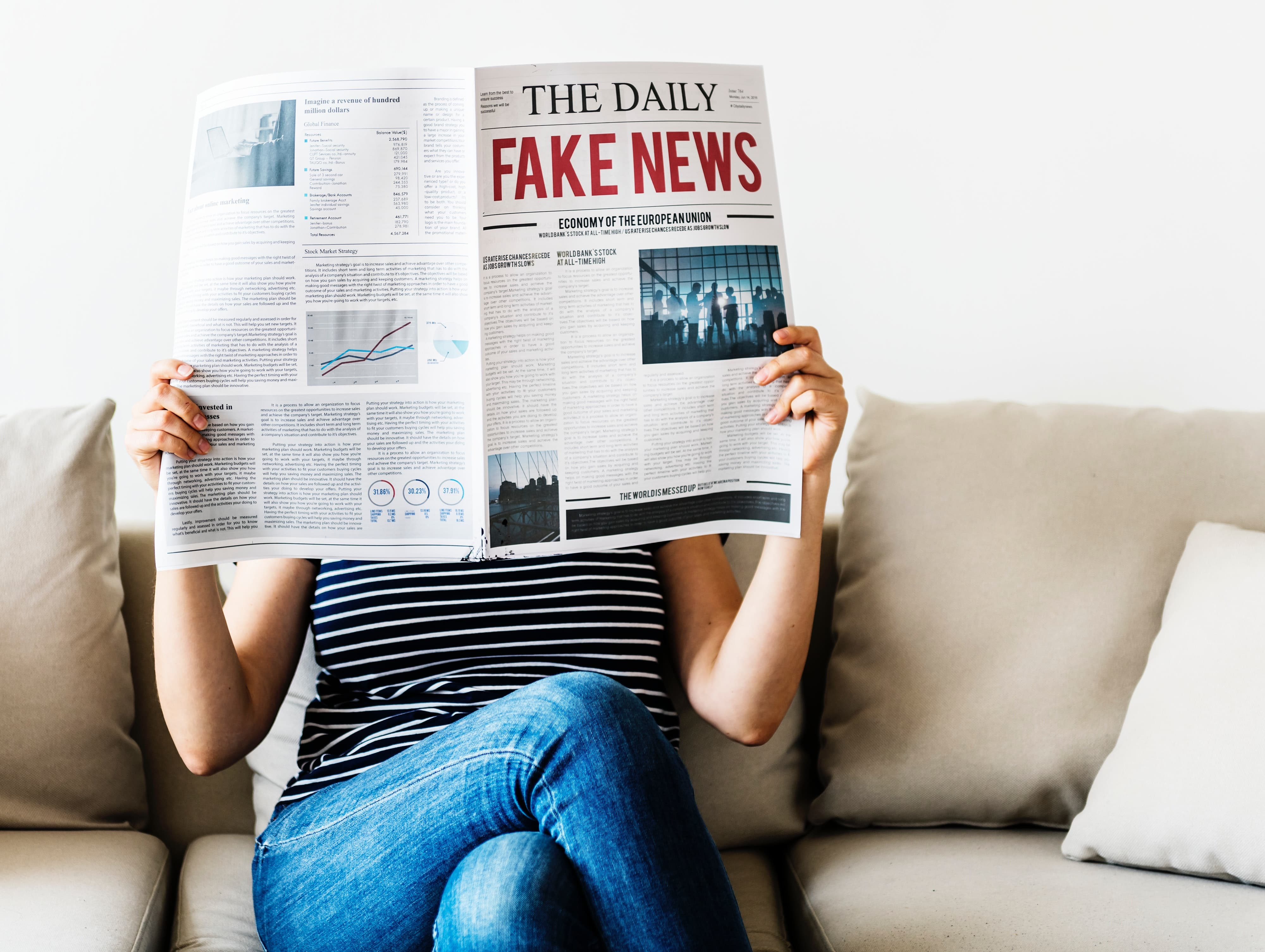 newspaper showing fake news