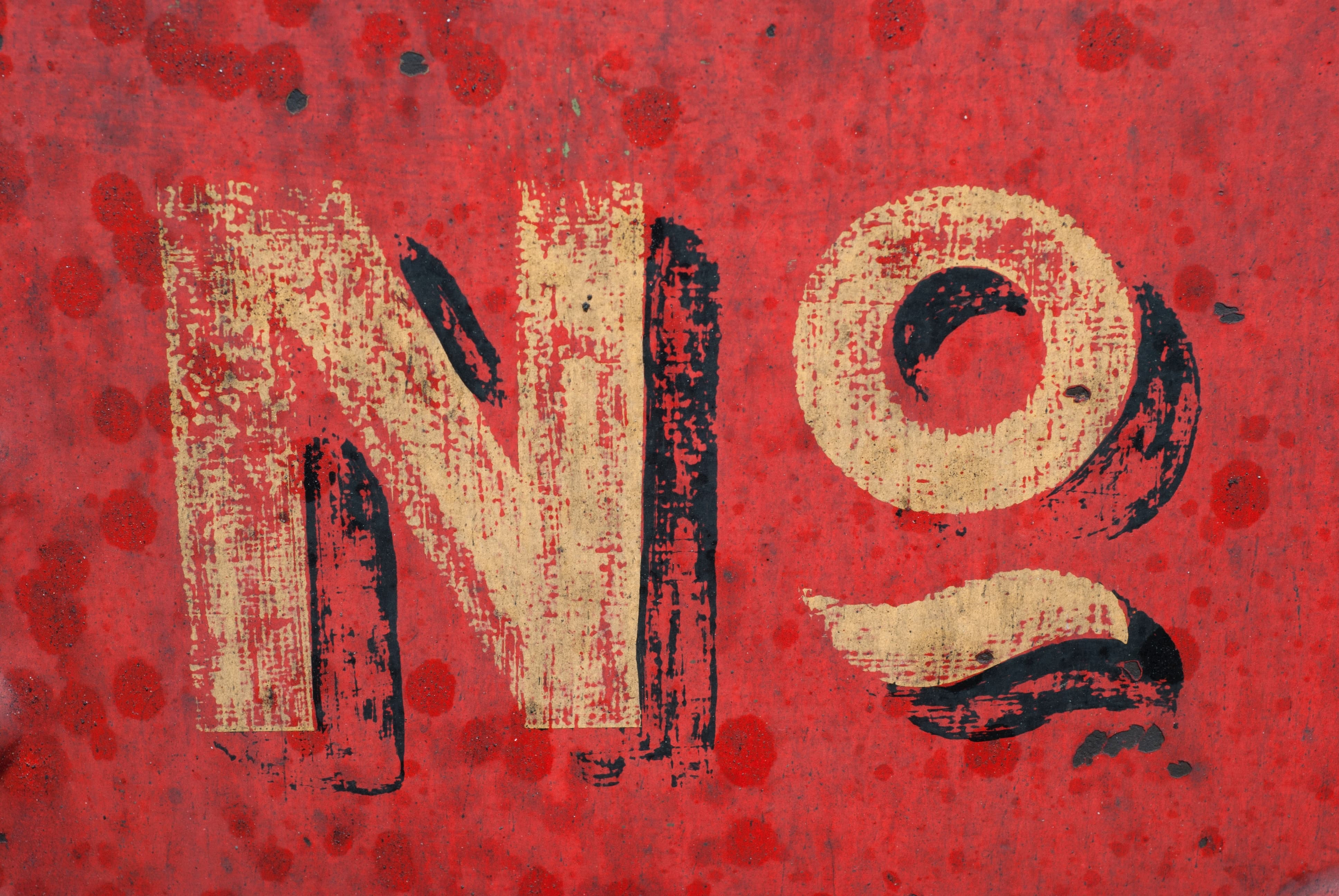 A hand painted sign which says 'No'.