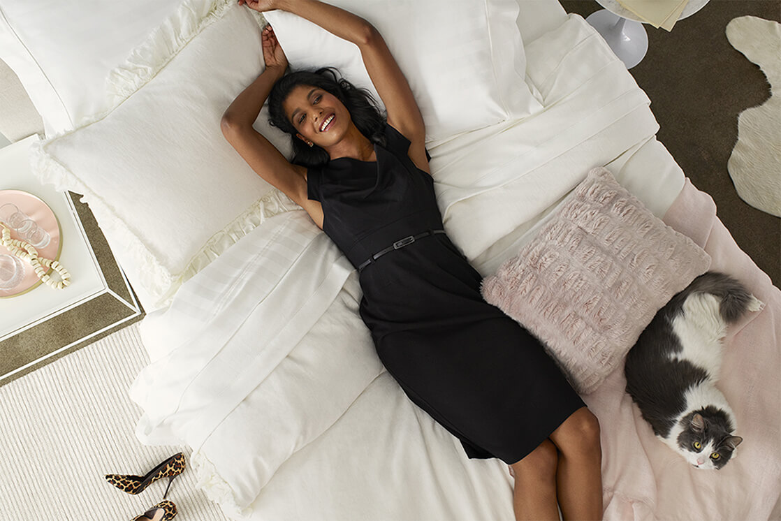 Woman Laying on Wamsutta Sheets