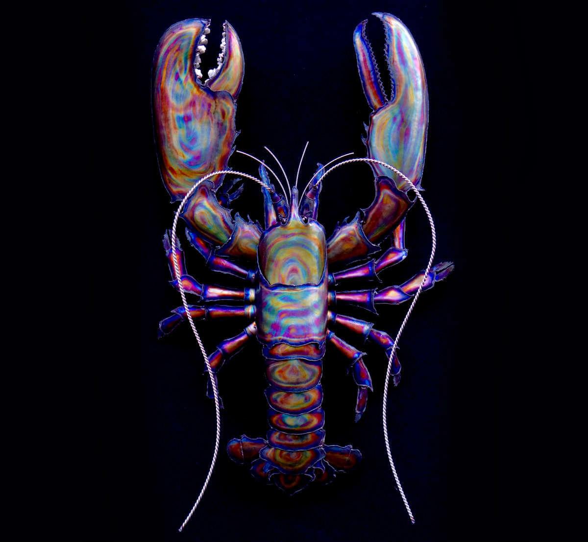 Metal striped lobster sculpture