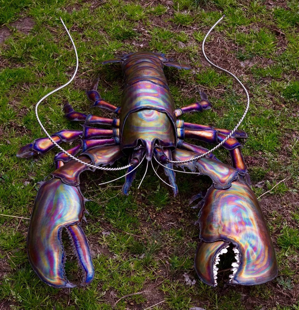 Close up of face of metal striped lobster sculpture