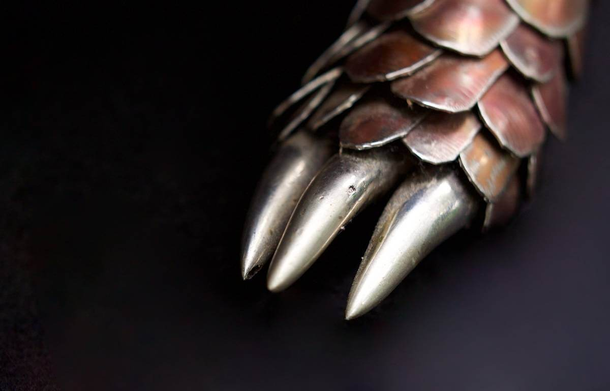 Detailed close up of claws of metal pangolin sculpture
