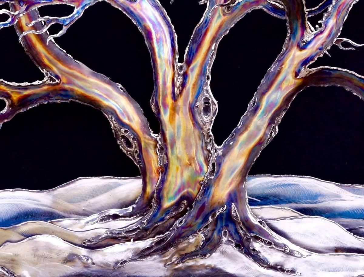Close up of metal snow laden tree sculpture