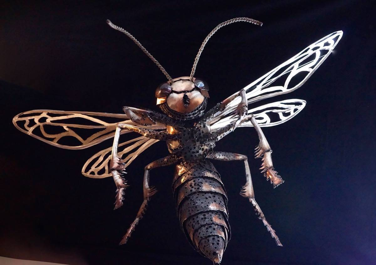 Metal wasp sculpture from below