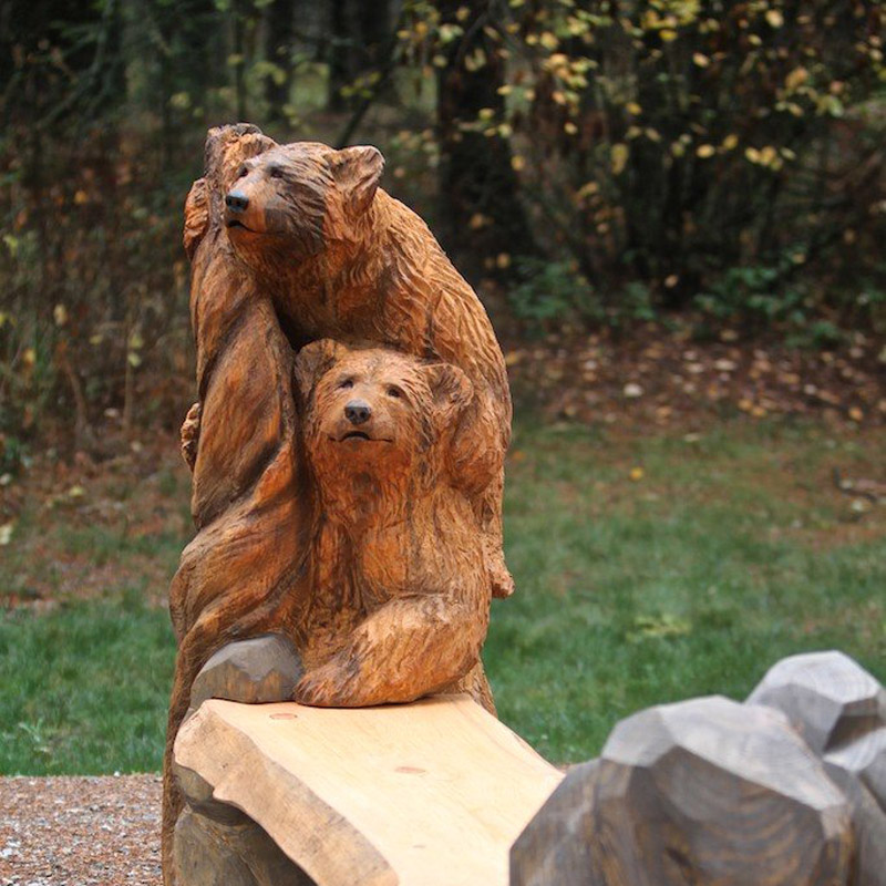 Wood carved bench with bears