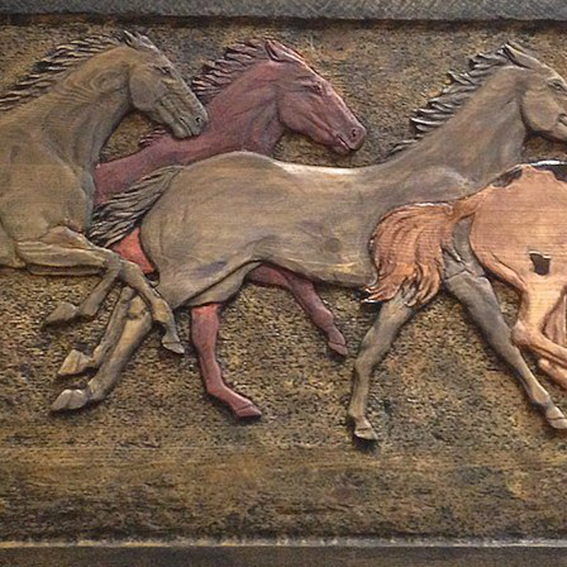 Wooden wild horses carving