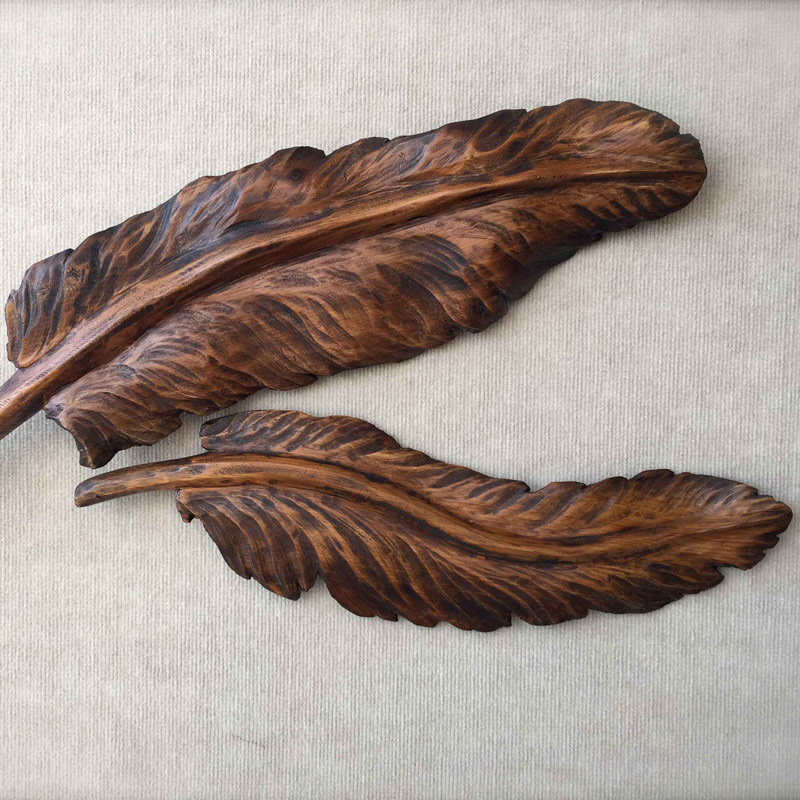 Carved wooden feathers
