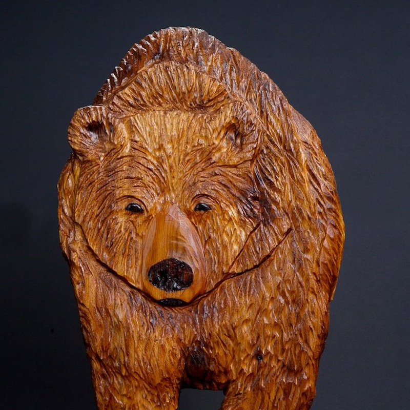 Carved grizzly bear wall relief