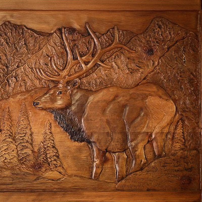 Carved elk relief panel