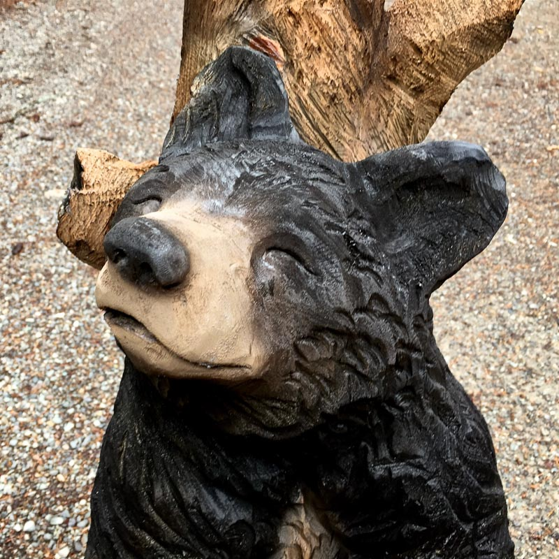 wood carved back scratching black bear