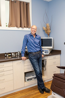 Dr. Ray Weiss in his office