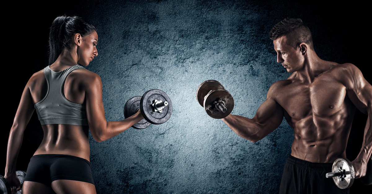 man and woman holding weights