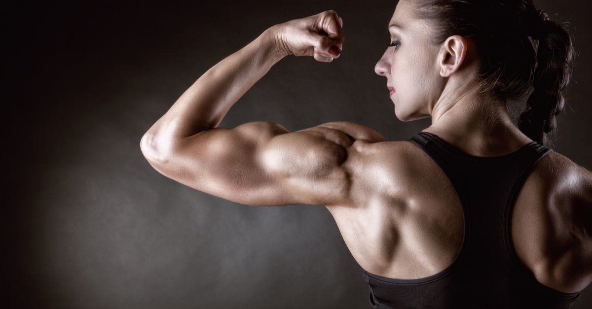 girl with dark hair flexing bicep