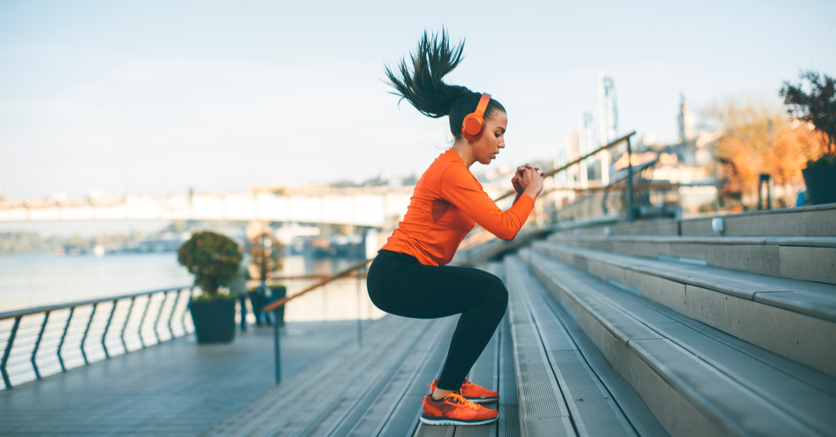 fitness woman jumping on steps