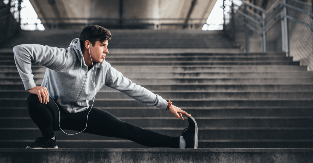 runner stretching on steps