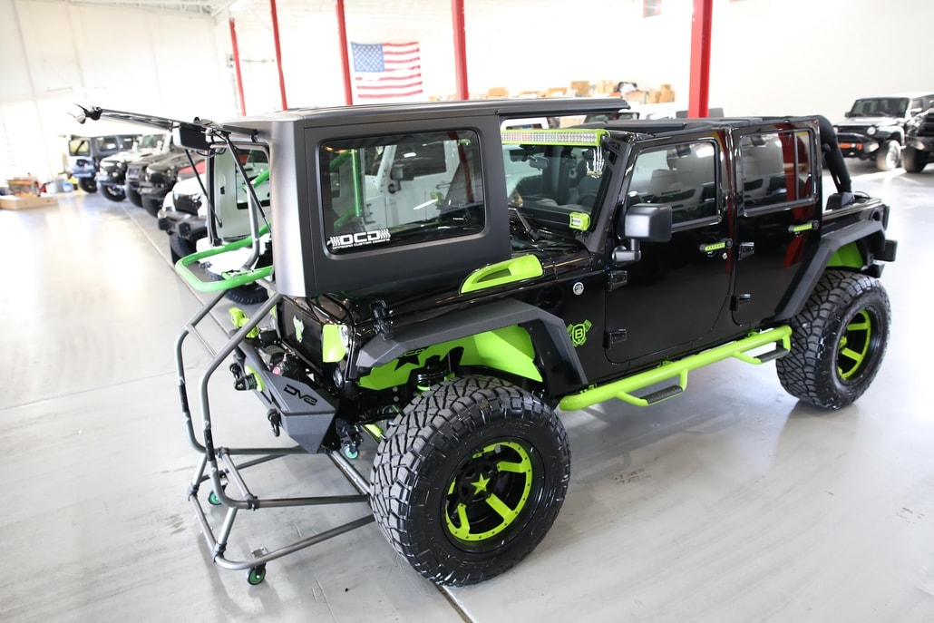 TopLift Pro parked in garage with Jeep
