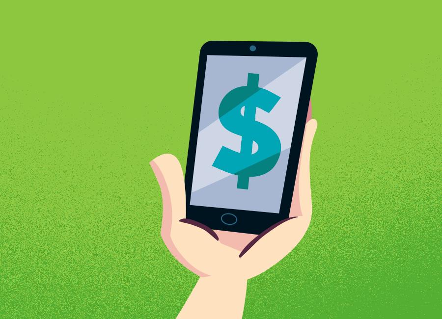 Mão segura um celular com cifrão na tela