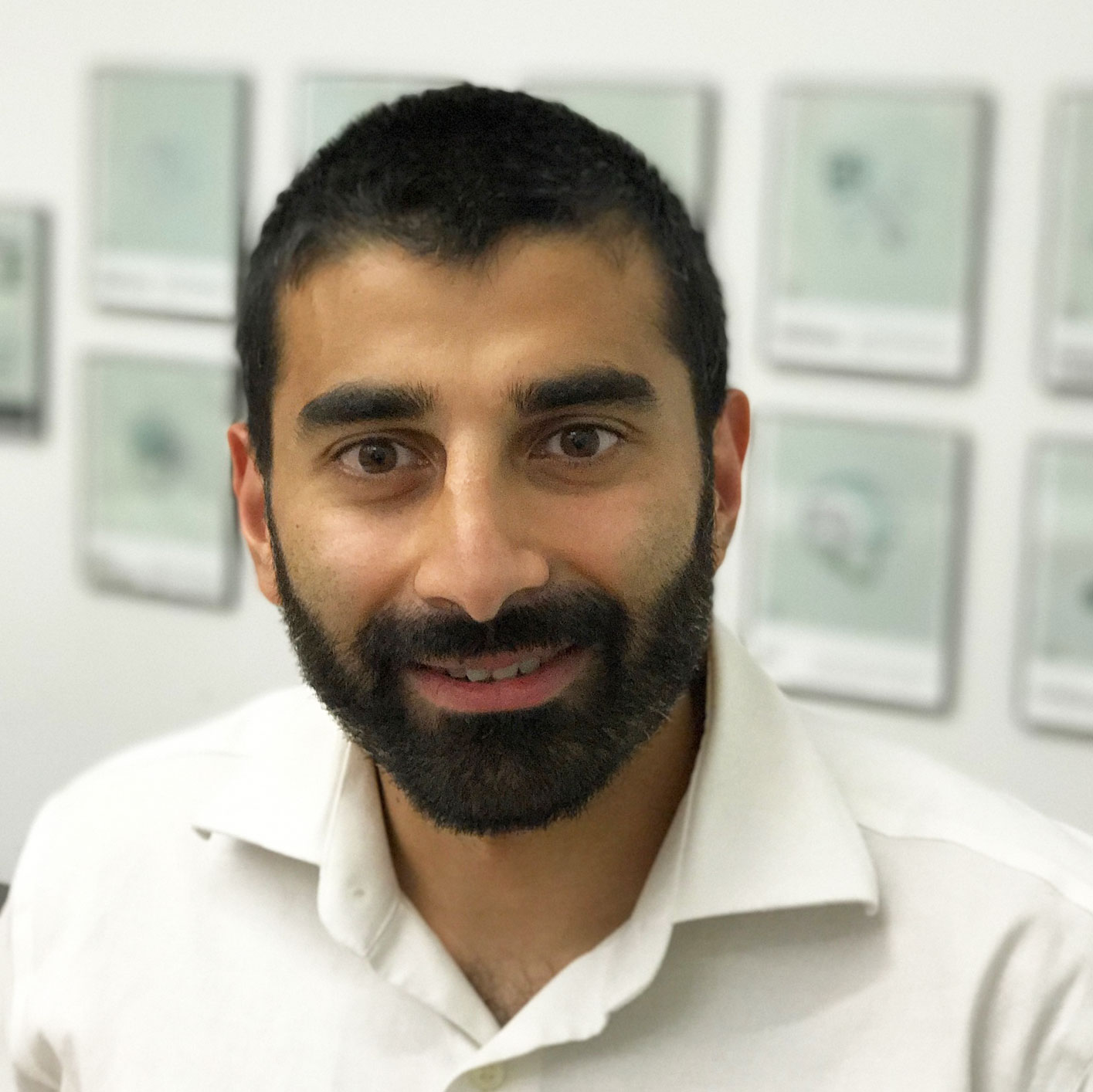 Sameer, wearing a beard and smiling