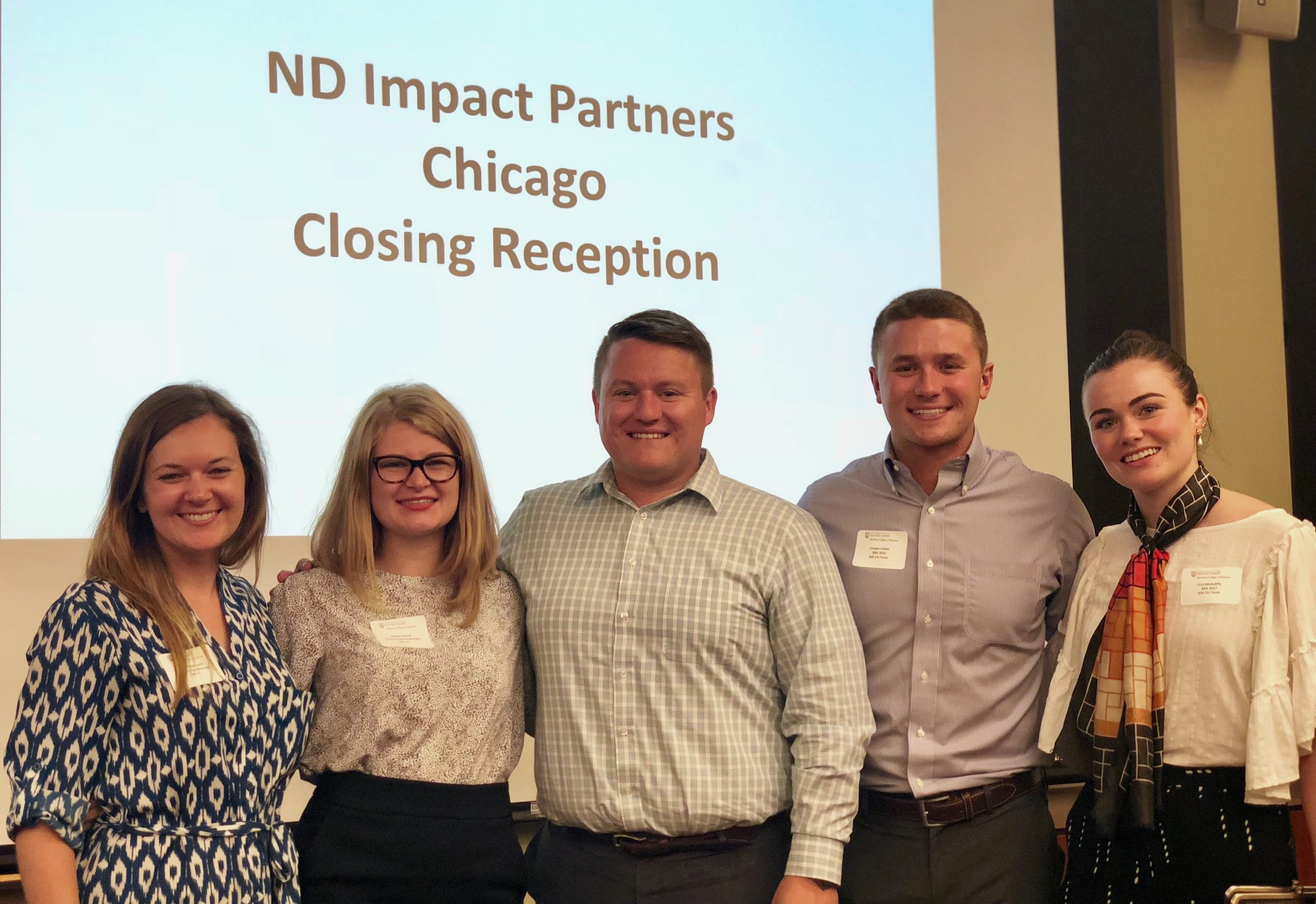 Group of five people from Notre Dame Impact Partners, smiling