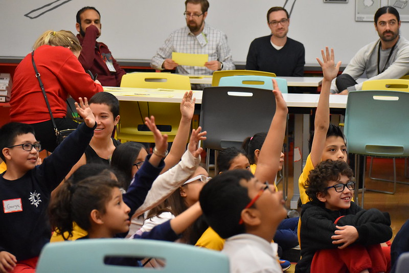 826CHI students raise their hands during a field trip!