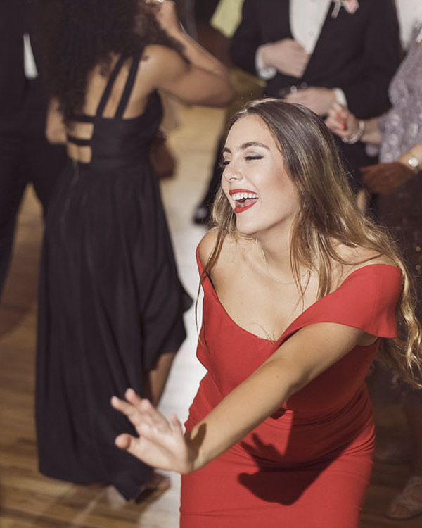 A happy guest dances the night away at her family's reunion