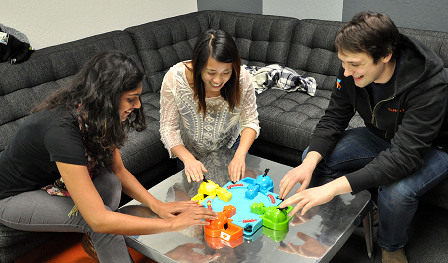 Quartzy team playing Hungry Hungry Hippos