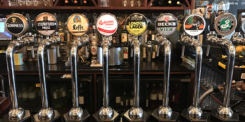 various draught beer pumps on bar