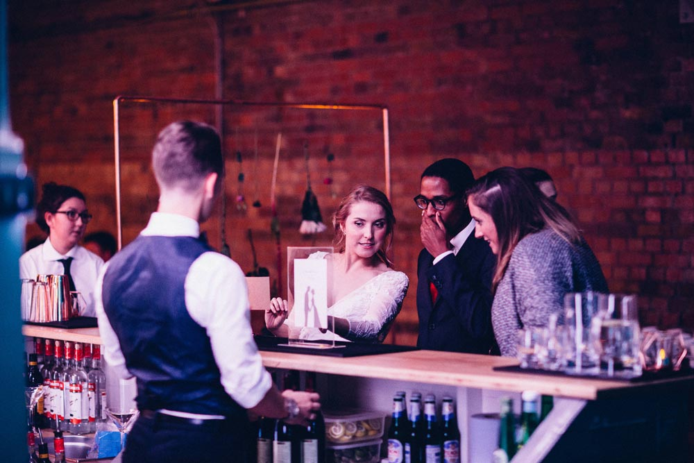 Bride at bar ordering drink