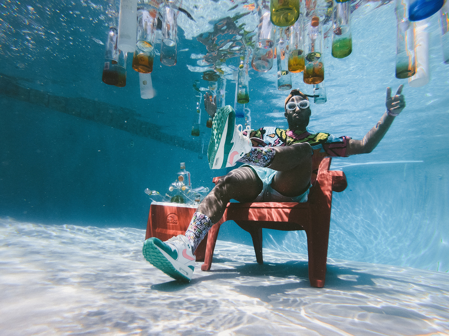 Guy sitting on a chair underwater