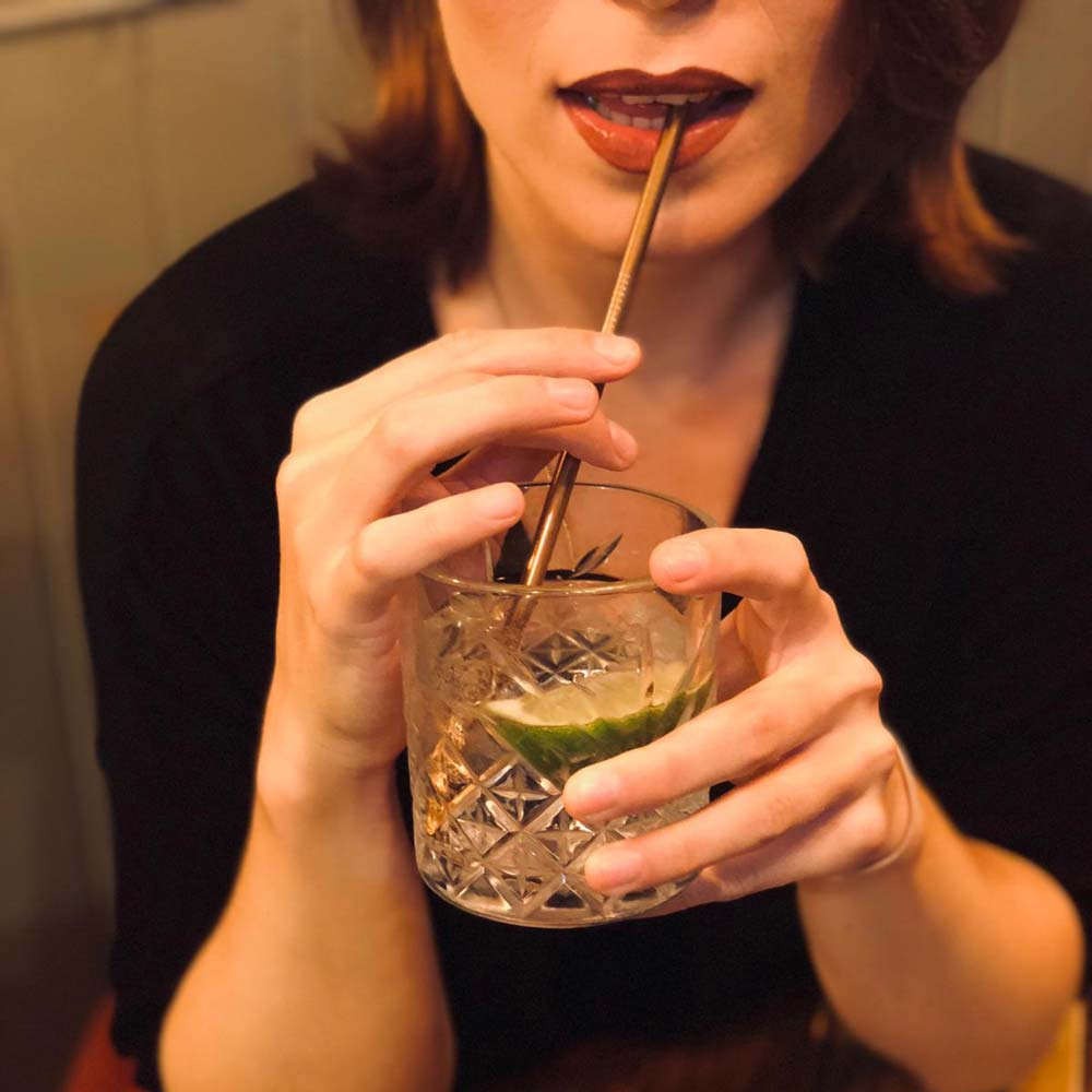 women drinking with straw for life
