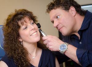 Dr. Gergits examines patient seeking treatment for chronic sinusitis